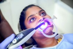 patient undergoing restoration at dental care in coimbatore